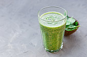 Healthy green smoothie with spinach in a glass mug, drink banner