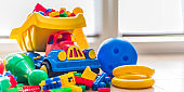 Colorful plastic children toys on the floor