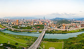 Taipei City Aerial View - Asia business concept image, panoramic modern cityscape building bird's eye view under sunrise and morning blue bright sky, shot in Taipei, Taiwan