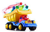 Colorful plastic toy truck loaded with plasctic bottles