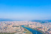 Taipei City Aerial View - Asia business concept image, panoramic modern cityscape building bird's eye view under daytime and blue sky, shot in Taipei, Taiwan.