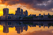 London cityscape financial district with reflection from river Thames at sunset