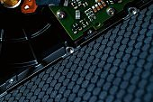 abstract technology background with hard drive microchip board