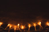 Electric lighted garland on wooden background