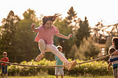 Excited girl is having fun while skipping jump rope