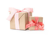 set of beautiful gift boxes with pink handmade ribbons. isolated on white