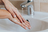 Hygiene concept. Wash hands with soap under the tap with water. disinfection