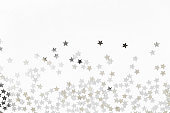 Silver sweets in the form of stars, glitter isolated on white background merry christmas party decoration, valentines day, mother's day and background design