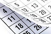 Closes a calendar page in blue. flipping calendar 2020