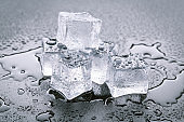 Pyramid of beautiful thawed ice cubes with drops of water