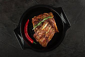Baked pork ribs with rosemary and hot pepper