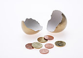 EGG AND COINS, SYMBOLIC IMAGE