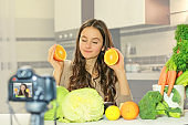 Teenage blogger explains to her followers how to eat healthy. Concept of communication among young people on the importance of healthy eating habits, vitamins and calories.