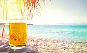 Beer in mug on beach