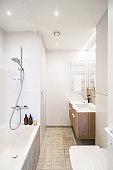 Bathroom with a bathtub, bright white colors