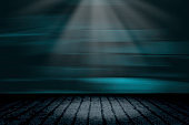 product background showcase display with grunge concrete floor and dark abstract movement blurred blue wall with a spotlight at empty of product presentation position