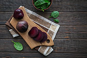 Ingredients for making healthy vegan food with sliced beetroot and spinach.