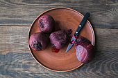 Boiled beetroot on clay plate.