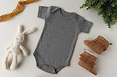 Gender Neutral Blank Grey Baby Bodysuit Flat lay Mockup - Baby Clothing Mock Up - Styled Stock Photography