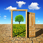 Open door to the spring landscape. Climate change concept.