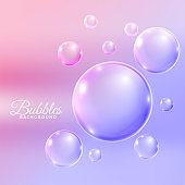 Shiny water bubbles background on blue background.Underwater floating bubbles background with sun rays.Blue water or soap bubbles background.Water or soap bubbles floating.Bubbles fizz floating upward.Abstract water or soap bubbles background.