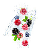 berry mix in water splash isolated on a white background