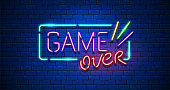 Game Over. Neon Text Sign with a Brick Wall Background. Illustration.