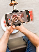 Man preparing meatballs recording video smartphone