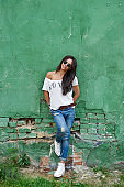 Outdoor street fashion portrait of stylish woman in sunglasses - full length