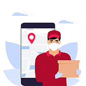 COVID-19. Coronavirus epidemic. Courier man in a protective medical mask holds a parcel. Online ordering of goods and food. Safe delivery.