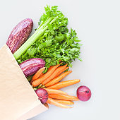 Fresh organic vegetables in craft shopping bag