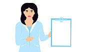 Medical woman doctor hold clipboard with copy space. Nurse standing in white lab coat.