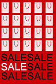 text sale and white shopping bags