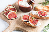 ciabatta or bruschetta with cottage cheese, figs and honey. sandwich with figs and goat cheese