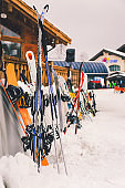 Snowboards and ski touring equipment in mounting resort
