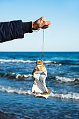 man fishing a used plastic bottle in the sea