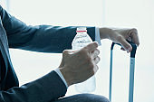businessman drinking bottled water at the airport