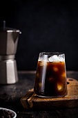 Iced Black Coffee on wooden background. Delicious ice coffee americano