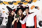 Asian group of friend selfie in Halloween party
