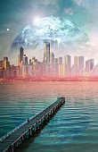 Science fiction book cover design. Alien planet landscape - Long wooden pier stretching into the ocean at sunset with modern city skyscrapers skyline and planet on the horizon. Elements of this image are furnished by NASA