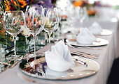 Table setting for a wedding or dinner event, with flowers