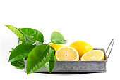 Sliced Lemon with green leaves on Zinc tray