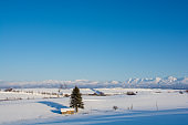 Snow fields and mountains with the blue sky