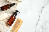 Flat lay composition with shaving razor, brush, foam gel bottle, soap, towel. Bathroom accessories for man, face skincare concept.