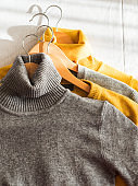 Yellow illuminated color and gray winter sweaters