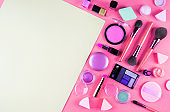 Make up accessories on pink. Flat lay
