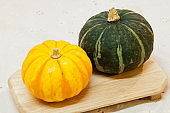 Cute yellow pumpkin and green pumpkin
