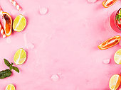Summer pink background with citrus slices