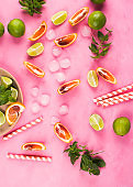 Summer pattern with citrus slices and red drink