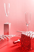 Bottle of rose wine and flutes, golden branches